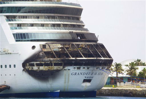 The fire-damaged exterior of Royal Caribbean&#39;s Grandeur of the Seas cruise ship is seen while docked in Freeport, Grand Bahama island, Monday, May 27, 2013. Royal Caribbean said the fire occurred early Monday while on route from Baltimore to the Bahamas on the mooring area of deck 3 and was quickly extinguished. All 2,224 guests and 796 crew were safe and accounted for. &#40;AP Photo&#47;The Freeport News, Jenneva Russell&#41; <span class=meta>(AP Photo&#47; Jenneva Russell)</span>