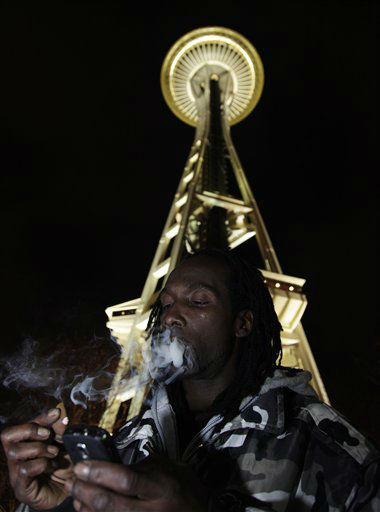 "<div class=""meta ""><span class=""caption-text "">Allister Adams smokes marijuana, Thursday, Dec. 6, 2012, just after midnight at the Space Needle in Seattle. Possession of marijuana became legal in Washington state at midnight, and several hundred people gathered at the Space Needle to smoke and celebrate the occasion, even though the new law does prohibit public use of marijuana. (AP Photo/Ted S. Warren) (AP Photo/ Ted S. Warren)</span></div>"