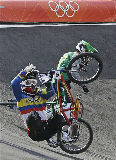 Ecuador&#39;s Emilio Andres Falla Buchely &#40;50&#41;, collides with Brazil&#39;s Renato Rezende, blocked from view, during a BMX cycling men&#39;s quarterfinal run during the 2012 Summer Olympics in London, Thursday, Aug. 9, 2012. &#40;AP Photo&#47;Sergey Ponomarev&#41; <span class=meta>(AP Photo&#47; Sergey Ponomarev)</span>
