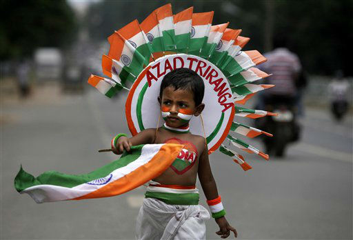 A young Indian child carries the Indian flag as he takes part in a street play during rehearsal for the Indian Independence Day celebrations in the eastern Indian city Bhubaneswar, India, Tuesday, Aug. 14, 2012. India celebrates its 1947 independence from British colonial rule on Aug. 15. &#40;AP Photo&#47;Biswaranjan Rout&#41; <span class=meta>(AP Photo&#47; Biswaranjan Rout)</span>