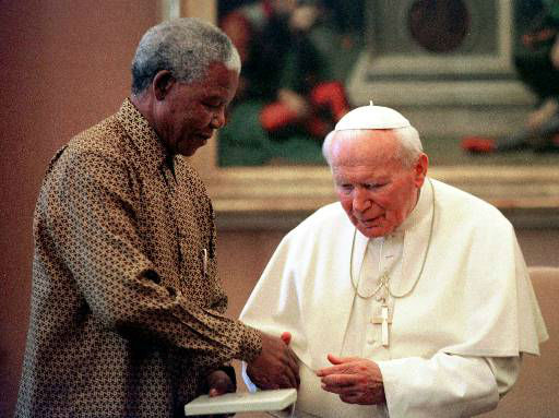 "<div class=""meta ""><span class=""caption-text "">Pope John Paul II and South African President Nelson Mandela shake hands during a private audience the pontiff granted to Mandela at the Vatican Thursday, June 18, 1998. Mandela is in Italy for a two-day official visit. (AP Photo/Pool/Paolo Cocco) (AP Photo/ PAOLO COCCO)</span></div>"