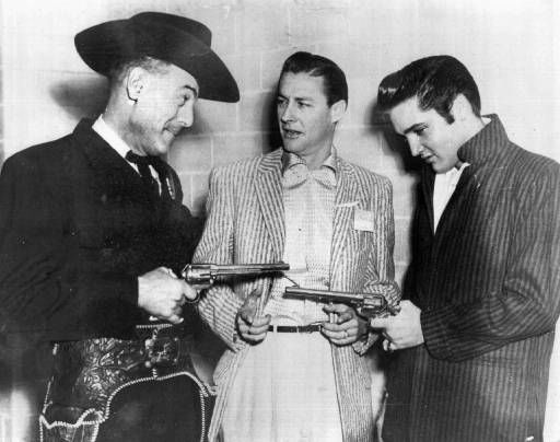 "<div class=""meta ""><span class=""caption-text "">Elvis Presley, right, and Horace Logan, left, pose with disc jockey Ed Hamilton backstage at the Louisiana Hayride in Shreveport, La., in an undated photo. In October 1954 Logan introduced the teen-age Elvis Presley to America by saying ""Ladies and gentlemen, you've never heard of this young man before, but one day you'll be able to tell your children and grandchildren you heard musical history made tonight.""  (AP Photo/Louisiana Hayride) (AP Photo/ Anonymous)</span></div>"