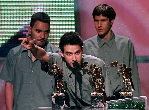 Adam Yauch, center, and members of the group The Beastie Boys accept their Video Vanguard Award during the MTV Video Music Awards in Los Angeles, Thursday night, Sept. 10, 1998. &#40;AP Photo&#47;Kevork Djansezian&#41; <span class=meta>(AP Photo&#47; KEVORK DJANSEZIAN)</span>