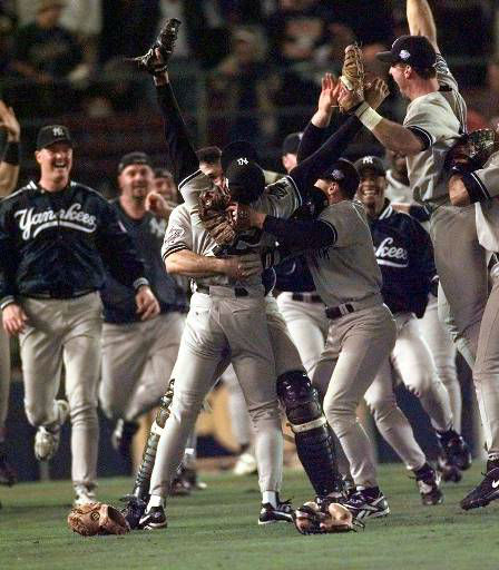 New York Yankees pitcher Mariano Rivera has both arms raised as he&#39;s hugged by catcher Joe Girardi after the Yanks won the World Series at Qualcomm Stadium in San Diego Wednesday, Oct. 21, 1998.Yanks swept the series with a 3-0 win. &#40;AP Photo&#47;Lenny Ignelzi&#41; <span class=meta>(AP Photo&#47; LENNY IGNELZI)</span>