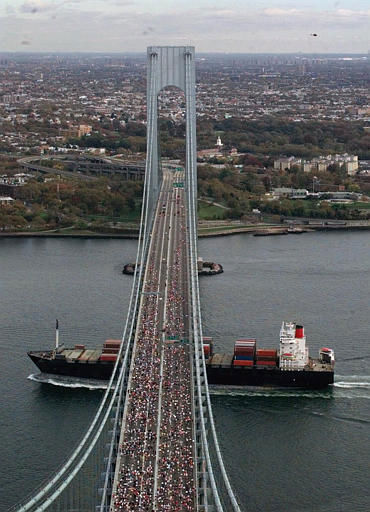 A container ship passes under runners that fill the roadway of the Verrazano Bridge at the start of the 1998 New York City Marathon, Sunday Nov. 1, 1998.  &#40;AP Photo&#47;Richard Drew&#41; <span class=meta>(AP Photo&#47; RICHARD DREW)</span>