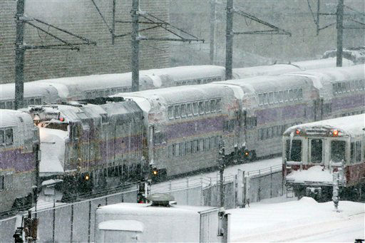 Massachusetts Bay Transportation Authority trains sit idle early Saturday, Feb. 9, 2013 in Boston due to high winds and the nearly two-feet of snow that fell in the area overnight. &#40;AP Photo&#47;Gene J. Puskar&#41; <span class=meta>(AP Photo&#47; Gene J. Puskar)</span>