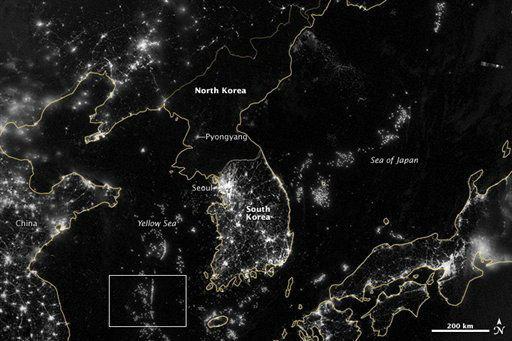 In this image from Sept. 24, 2012 provided by NASA, the Korean Peninsula is seen at night from a composite assembled from data acquired by the Suomi NPP satellite. The image was made possible by the new satellite&#39;s &#34;day-night band&#34; of the Visible Infrared Imaging Radiometer Suite &#40;VIIRS&#41;, which detects light in a range of wavelengths from green to near-infrared and uses filtering techniques to observe dim signals such as city lights, gas flares, auroras, wildfires, and reflected moonlight. City lights at night are a fairly reliable indicator of where people live. But this isn&#39;t always the case, and the Korean Peninsula shows why. As of July 2012, South Korea&#39;s population was estimated at roughly 49 million people, and North Korea&#39;s population was estimated at about half that number. But where South Korea is gleaming with city lights, North Korea has hardly any lights at all, just a faint glimmer around Pyongyang. The wide-area image shows the Korean Peninsula, parts of China and Japan, the Yellow Sea, and the Sea of Japan. The white inset box encloses an area showing ship lights in the Yellow Sea. Many of the ships form a line, as if assembling along a watery border. &#40;AP Photo&#47;NASA&#41; <span class=meta>(AP Photo&#47; Uncredited)</span>