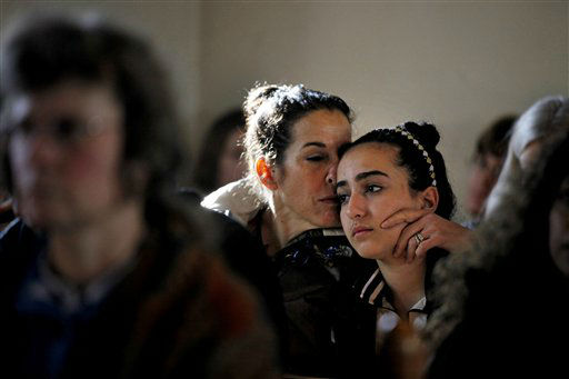 Elizabeth Bogdanoff, left, kisses her daughter Julia, 13, both of Newtown, Conn., during a prayer service at St John&#39;s Episcopal Church, Saturday, Dec. 15, 2012, in Newtown, Conn. The massacre of 26 children and adults at Sandy Hook Elementary school elicited horror and soul-searching around the world even as it raised more basic questions about why the gunman, 20-year-old Adam Lanza, would have been driven to such a crime and how he chose his victims. &#40;AP Photo&#47;David Goldman&#41; <span class=meta>(AP Photo&#47; David Goldman)</span>