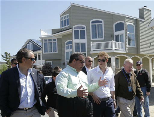 "<div class=""meta ""><span class=""caption-text "">New Jersey Gov. Chris Christie, center left, walks with Britain's Prince Harry, center, while visiting the area hit by Superstorm Sandy, Tuesday, May 14, 2013, in Seaside Heights, N.J. New Jersey sustained about $37 billion worth of damage from the storm. (AP Photo/Mel Evans, Pool) (AP Photo/ Mel Evans)</span></div>"