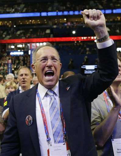 Scott Romney, right, brother of U.S. Republican presidential candidate Mitt Romney, reacts at the Republican National Convention in Tampa, Fla., on Tuesday, Aug. 28, 2012. &#40;AP Photo&#47;Charles Dharapak&#41; <span class=meta>(AP Photo&#47; Charles Dharapak)</span>