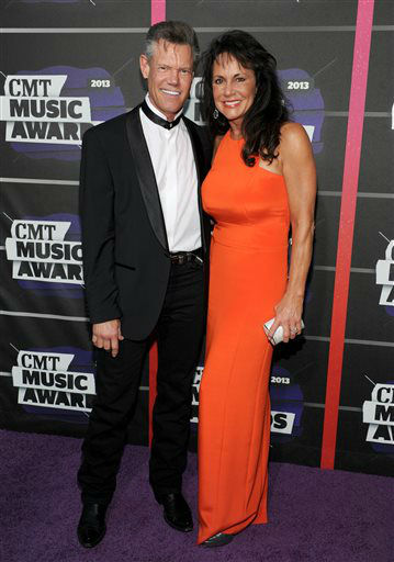 Randy Travis, left, and Mary Beougher arrive at the 2013 CMT Music Awards at Bridgestone Arena on Wednesday, June 5, 2013, in Nashville, Tenn. &#40;Photo by Frank Micelotta&#47;Invision&#47;AP&#41; <span class=meta>(Photo&#47;Frank Micelotta)</span>