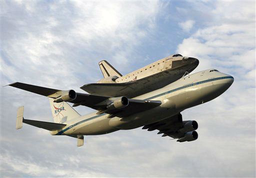 Space shuttle Endeavour, bolted atop a modified jumbo jet, makes its departure from the Kennedy Space Center, Wednesday, Sept. 19, 2012, in Cape Canaveral, Fla. Endeavour will make a stop in Houston before heading to the California Science Center in Los Angeles.&#40;AP Photo&#47;Terry Renna&#41; <span class=meta>(AP Photo&#47; Terry Renna)</span>