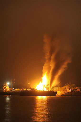 Fire burns aboard two fuel barges along Mobile River after explosions sent three workers to the hospital. Fire officials have pulled units back from fighting the fire due to the explosions and no immediate threat to lives. &#40;AP Photo John David Mercer&#41; <span class=meta>(AP Photo&#47; John David Mercer)</span>