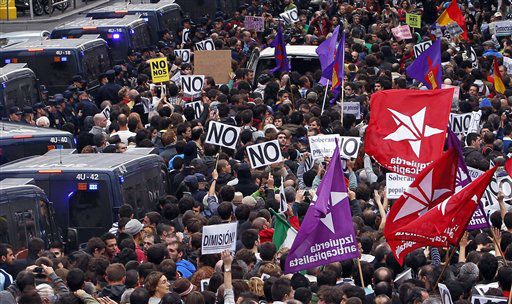 "<div class=""meta ""><span class=""caption-text "">Protestors march to the parliament against austerity measures announced by the Spanish government in Madrid, Spain, Tuesday, Sept. 25, 2012. Spain's Parliament has taken on the appearance of a heavily guarded fortress with dozens of police blocking access from every possible angle, hours ahead of a protest against the conservative government's handling of the economic crisis. The demonstration, organized behind the slogan 'Occupy Congress,' is expected to draw thousands of people. It is due to start around 1730 GMT Tuesday. Madrid authorities said some 1,300 police would be deployed. The protestors call for Parliament to be dissolved and fresh elections held, claiming the government's austerity measures show the ruling Popular Party misled voters to get elected last November. (AP Photo/Andres Kudacki) (AP Photo/ Andres Kudacki)</span></div>"
