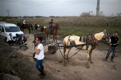 "<div class=""meta ""><span class=""caption-text "">Israelis stop after an air raid siren warning of incoming rockets from Gaza, next to an Iron Dome defense system in Tel Aviv, Saturday, Nov. 17, 2012.Israel bombarded the Hamas-ruled Gaza Strip with nearly 200 airstrikes early Saturday, the military said, widening a blistering assault on Gaza rocket operations to include the prime minister's headquarters, a police compound and a vast network of smuggling tunnels. (AP Photo/Oded Balilty) (AP Photo/ Oded Balilty)</span></div>"