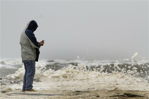 A man watch the rough surf and sea foam near Great Egg Harbor Inlet, in Longport N.J., Sunday, Oct. 28, 2012, as the area prepares for Hurricane Sandy. Tens of thousands of people were ordered to evacuate coastal areas Sunday as big cities and small towns across the U.S. Northeast braced for the onslaught of a superstorm threatening some 60 million people along the most heavily populated corridor in the nation.  &#40;AP Photo&#47; Joseph Kaczmarek&#41; <span class=meta>(AP Photo&#47; Joseph Kaczmarek)</span>