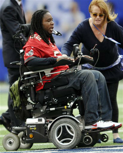 Paralyzed former Rutgers player Eric LeGrand moves to center field before an NFL football game between the New York Giants and the Tampa Bay Buccaneers, Sunday, Sept. 16, 2012, in East Rutherford, N.J. LeGrand took park in the coin toss at MetLife Stadium. &#40;AP Photo&#47;Bill Kostroun&#41; <span class=meta>(AP Photo&#47; Bill Kostroun)</span>