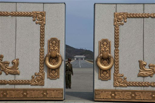A North Korean soldier guarding the entrance to Pyongyang&#39;s Kumsusan mausoleum, where the bodies of the late leaders Kim Il Sung and Kim Jong Il lie embalmed, looks back through the doors of the main gate Monday, April 15, 2013. North Koreans turned out on Monday to mark the 101st birthday of Kim Il Sung. &#40;AP Photo&#47;David Guttenfelder&#41; <span class=meta>(AP Photo&#47; David Guttenfelder)</span>