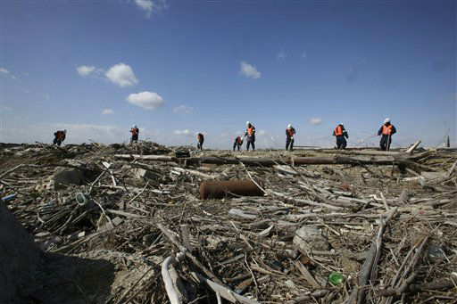 "<div class=""meta ""><span class=""caption-text "">Police officers search for the remains of those who went missing in the March 11, 2011 tsunami on the coastline in Ishinomaki, Miyagi Prefecture, northern Japan, Monday, March 11, 2013. The two-year anniversary Monday of Japan's devastating earthquake, tsunami and nuclear catastrophe is serving to spotlight the stakes of the country's struggles to clean up radiation, rebuild lost communities and determine new energy and economic strategies.(AP Photo/Shizuo Kambayashi) (AP Photo/ Shizuo Kambayashi)</span></div>"