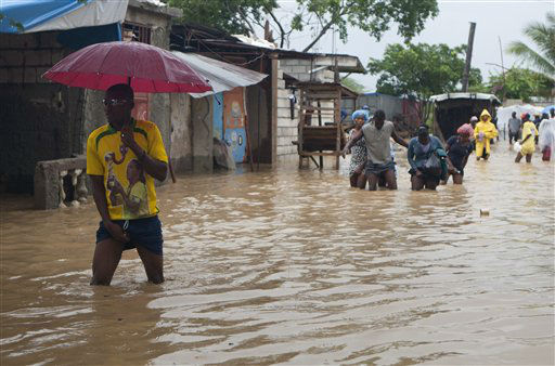 "<div class=""meta ""><span class=""caption-text "">Residents wade through a flooded street caused by heavy rains from Hurricane Sandy in Port-au-Prince, Haiti, Thursday, Oct. 25, 2012. Hurricane Sandy rumbled across mountainous eastern Cuba and headed toward the Bahamas on Thursday as a Category 2 storm, bringing heavy rains and blistering winds.  (AP Photo/Dieu Nalio Chery) (AP Photo/ Dieu Nalio Chery)</span></div>"