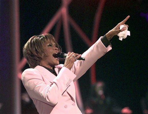 FILE - In this July 11, 1999, file photo, singer Whitney Houston performs &#34;Until You Come Back To Me&#34; during the 26th annual American Music Awards at the Shrine Auditorium in Los Angeles. Publicist Kristen Foster said, Saturday, Feb. 11, 2012, that singer Whitney Houston has died at age 48.   &#40;AP Photo&#47;Kevork Djansezian, File&#41; <span class=meta>(AP Photo&#47; KEVORK DJANSEZIAN)</span>