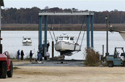 "<div class=""meta ""><span class=""caption-text "">As another boat waits its turn, a 50-ton lift raises Fancy Nancy, a 40-foot commercial fishing boat, out of the Maurice River at Yank Marine Services marina Saturday, Oct. 27, 2012, in Dorchester, N.J., in preparation for Hurricane Sandy. From the lowest lying areas of the Jersey Shore, where residents were already being encouraged to leave, to the state's northern highlands, where sandbags were being filled and cars moved into parking lots on high ground, New Jersey began preparing in earnest for Sandy. (AP Photo/Mel Evans) (AP Photo/ Mel Evans)</span></div>"