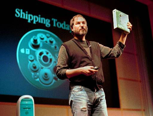 COMPANY CHIEF EXECUTIVE OFFICER FOUNDER ON STAGE WEARING BLUE JEANS SOFTWARE OS X SERVER SCREEN IN BACKGROUND BUSINESSMAN <span class=meta>(AP Photo&#47; BEN MARGOT)</span>