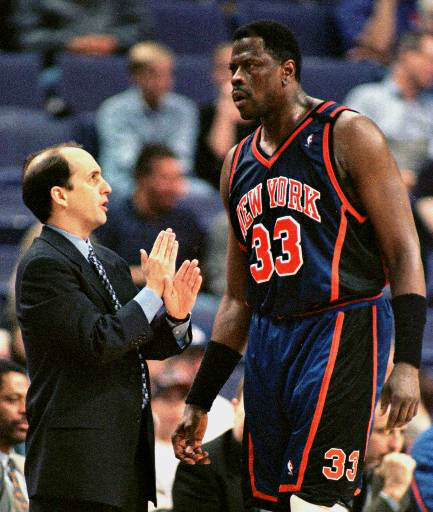 New York Knicks coach Jeff Van Gundy, whose job is considered in jeopardy, talks with center Patrick Ewing, who became only the 12th player in NBA history to reach 20,000 career points and 10,000 career rebounds, during the Friday night, March 26, 1999, game, with the Phoenix Suns in Phoenix. Ewing entered the game needing four rebounds and got them during the first half. &#40;AP Photo&#47;Jack Smith&#41; <span class=meta>(AP Photo&#47; JACK SMITH)</span>