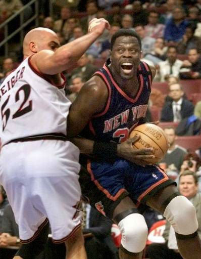New York Knicks&#39; Patrick Ewing, right, drives against Philadelphia 76ers&#39; Matt Geiger in the first half Monday, April 19, 1999 in Philladelphia.&#40;AP Photo&#47;rusty kennedy&#41; <span class=meta>(AP Photo&#47; RUSTY KENNEDY)</span>