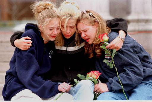 "<div class=""meta ""><span class=""caption-text "">From left, Rachel Ruth, Rhianna Cheek and Mandi Annibel, all 16-year-old sophomores at Heritage High School in Littleton, Colo., console each other during a vigil service in Denver's Civic Center Park late Wednesday, April 21, 1999, to honor the victims of the shooting spree in Columbine High School in the southwest Denver suburb of Littleton on Tuesday, April 20, 1999. (AP Photo/Laura Rauch) (AP Photo/ LAURA RAUCH)</span></div>"