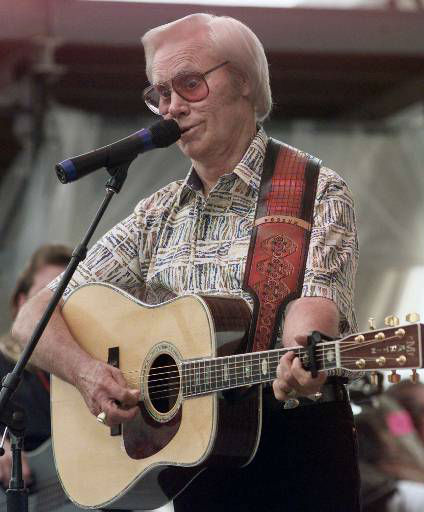 Country Music legend George Jones performs &#34;Sinners and Saints&#34; during the opening day of FanFair &#39;99 in Nashville, Tenn., on Monday, June 14, 1999.  This is Jones&#39; first performance in Nashville since his near fatal automobile accident earlier this year. &#40;AP Photo&#47;John Russell&#41; <span class=meta>(AP Photo&#47; JOHN RUSSELL)</span>