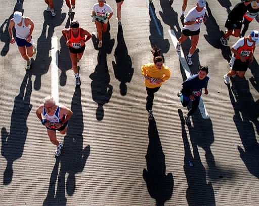 Runners in the New York City Marathon cast deep shadows as they run across the Pulaski Bridge in New York, Sunday, Nov. 7, 1999. The men&#39;s division was won by Joseph Chebet, of Kenya, with a time of 2:09:14. Chebet became the first to win both the Boston and New York marathons in the same year since Alberto Salazar in 1982. The women&#39;s race was won by Mexican Adriana Fernandez, whose time was 2:25:06, the second-fastest in the race&#39;s history. &#40;AP Photo&#47;Stephen Chernin&#41; <span class=meta>(AP Photo&#47; STEPHEN CHERNIN)</span>