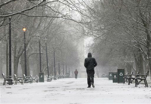 A pedestrian walks through the snow in Washington Park on Friday, Feb. 8, 2013, in Albany, N.Y. Parts of the New York region still cleaning up from Superstorm Sandy are bracing for a winter storm that&#39;s expected to blanket the Northeast with heavy snow Friday and Saturday. &#40;AP Photo&#47;Mike Groll&#41; <span class=meta>(Photo&#47;Mike Groll)</span>