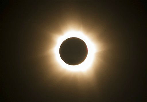 "<div class=""meta ""><span class=""caption-text "">In this photo provided by Tourism Queensland, the moment of a total solar eclipse is observed at Cape Tribulation in Queensland state, Australia, Wednesday, Nov. 14, 2012. Starting just after dawn, the eclipse cast its 150-kilometer (95-mile) shadow in Australia's Northern Territory, crossed the northeast tip of the country and was swooping east across the South Pacific, where no islands are in its direct path. (AP Photo/Tourism Queensland) EDITORIAL USE ONLY (AP Photo/ Uncredited)</span></div>"