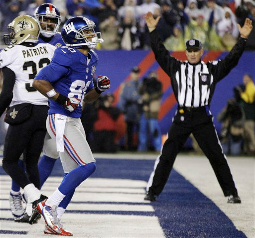 New York Giants wide receiver Victor Cruz &#40;80&#41; dances in the end zone to celebrate his 10-yard touchdown catch during the second half of an NFL football game against the New Orleans Saints, Sunday, Dec. 9, 2012, in East Rutherford, N.J. At left is Saints cornerback Johnny Patrick &#40;32&#41;. &#40;AP Photo&#47;Kathy Willens&#41; <span class=meta>(AP Photo&#47; Kathy Willens)</span>