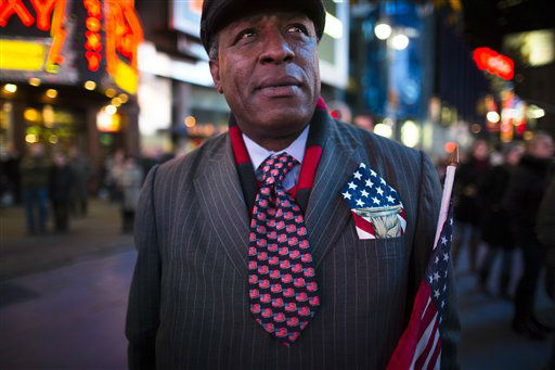 "<div class=""meta image-caption""><div class=""origin-logo origin-image ""><span></span></div><span class=""caption-text"">Howard Nizebeth, 48, watches election results in Times Square, Tuesday, Nov. 6, 2012, in New York. After a year of campaigning, polls have begun to close after Americans across the United States headed to the polls to decide the winner of the tight presidential race between President Barack Obama and former Massachusetts Governor Mitt Romney. (AP Photo/ John Minchillo) (AP Photo/ John Minchillo)</span></div>"