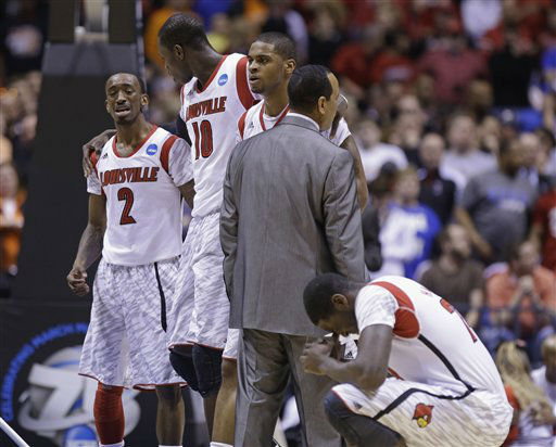 Louisville players Russ Smith &#40;2&#41;, Gorgui Dieng &#40;10&#41; and Montrezl Harrell, right, react to an injury to guard Kevin Ware during the first half of the Midwest Regional final against Duke in the NCAA college basketball tournament, Sunday, March 31, 2013, in Indianapolis. &#40;AP Photo&#47;Michael Conroy&#41; <span class=meta>(AP Photo&#47; Michael Conroy)</span>