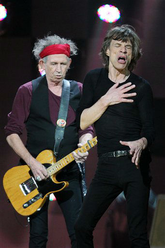 This image released by Starpix shows Keith Richards, left, and Mick Jagger of The Rolling Stones performing at the 12-12-12 The Concert for Sandy Relief at Madison Square Garden in New York on Wednesday, Dec. 12, 2012. Proceeds from the show will be distributed through the Robin Hood Foundation. &#40;AP Photo&#47;Starpix, Dave Allocca&#41; <span class=meta>(AP Photo&#47; Dave Allocca)</span>