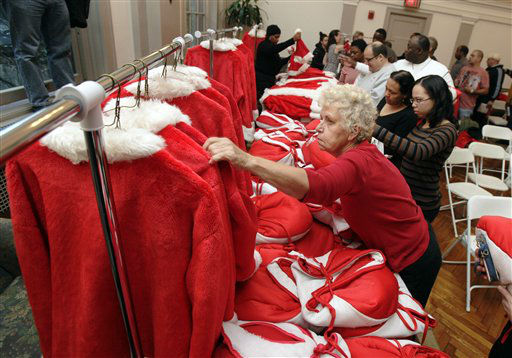 Kathy Trezza, foreground, chooses her outfit at Volunteers of America headquarters in New York, as she prepares for the 110th annual Sidewalk Santa Parade, Friday, Nov. 23, 2012. The donations they raise are used for a holiday food voucher program for needy residents. &#40;AP Photo&#47;Richard Drew&#41; <span class=meta>(AP Photo&#47; Richard Drew)</span>