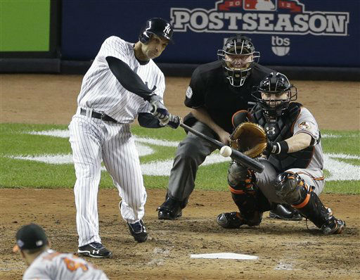 New York Yankees&#39; Raul Ibanez hits a solo home run to tie the game in the ninth inning in Game 3 of the American League division baseball series against the Baltimore Orioles on Wednesday, Oct. 10, 2012, in New York. The Orioles catcher is Matt Wieters and the umpire is Brian Gorman. &#40;AP Photo&#47;Peter Morgan&#41; <span class=meta>(AP Photo&#47; Peter Morgan)</span>