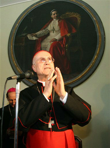 Italian Cardinal Tarcisio Bertone gestures after reading a statement in Genoa, northern Italy, under a painting of Giacomo Della Chiesa, Pope Benedict XV from Genoa, Thursday June 22, 2006. Pope Benedict XVI has decided to appoint Bertone as the Vatican&#39;s No. 2 official.  As the Vatican&#39;s secretary of state, Bertone would replace another Italian, Cardinal Angelo Sodano, who has held the post for 15 years and at 78 is three years past the normal Vatican retirement age. &#40;AP Photo&#47;Andrea Leoni&#41; <span class=meta>(AP Photo&#47; ANDREA LEONI)</span>