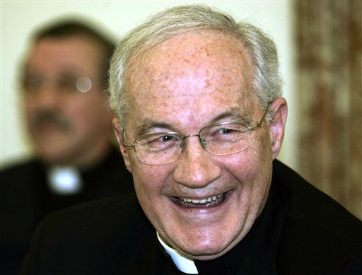**  FILE ** Cardinal Marc Ouellet, 60, Archbishop of Quebec City, Canada, smiles as he meets the media in downtown Rome, in this April 7, 2005 file photo. Perhaps he is too young, and from the wrong continent, but Cardinal Marc Ouellet of Quebec City has made at least one list of papal contenders that mentions no other American or Canadian cardinals. Though far from a front-runner, he has, in the eyes of some experts, the best chance of any North American cardinal to be John Paul II&#39;s successor. The National Catholic Reporter, a U.S.-based weekly, listed him as one of the top 20 candidates. &#40;AP Photo&#47;Lefteris Pitarakis&#47; File&#41; <span class=meta>(AP Photo&#47; LEFTERIS PITARAKIS)</span>
