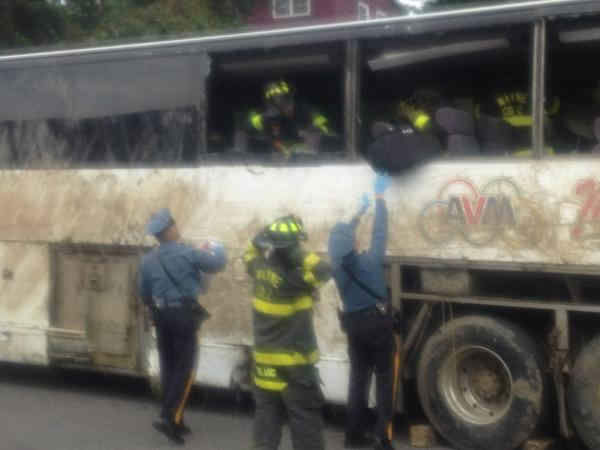 "<div class=""meta ""><span class=""caption-text "">A charter bus from Canada with 60 people on board overturned on a Rotue 80 exit ramp. (Darla Miles)</span></div>"