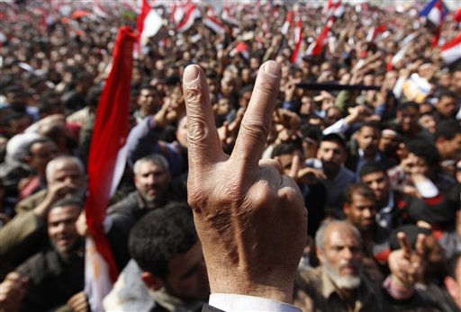 "<div class=""meta image-caption""><div class=""origin-logo origin-image ""><span></span></div><span class=""caption-text"">Anti-government protester  flashes V sign at Tahrir square, in Cairo, Egypt, Friday, Feb. 11, 2011. Egypt exploded with joy, tears, and relief after pro-democracy protesters brought down President Hosni Mubarak with a momentous march on his palaces and state TV. Mubarak, who until the end seemed unable to grasp the depth of resentment over his three decades of authoritarian rule, finally resigned Friday and handed power to the military. (AP Photo/Hussein Malla) (AP Photo/ Hussein Malla)</span></div>"