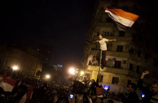"<div class=""meta image-caption""><div class=""origin-logo origin-image ""><span></span></div><span class=""caption-text"">Egyptians celebrate after President Hosni Mubarak resigned and handed power to the military in Cairo, Egypt, Friday, Feb. 11, 2011. Egypt exploded with joy, tears, and relief after pro-democracy protesters brought down President Hosni Mubarak with a momentous march on his palaces and state TV. Mubarak, who until the end seemed unable to grasp the depth of resentment over his three decades of authoritarian rule, finally resigned Friday and handed power to the military. (AP Photo/Emilio Morenatti) (AP Photo/ Emilio Morenatti)</span></div>"