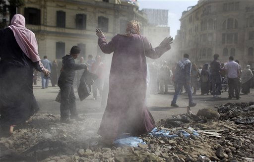 "<div class=""meta image-caption""><div class=""origin-logo origin-image ""><span></span></div><span class=""caption-text"">An Egyptian volunteer fans away dust as she cleans up garbage and rocks from the street outside the Egyptian Museum near Tahrir Square in Cairo, Egypt, Saturday, Feb. 12, 2011.  Egyptian protesters were jubilant Saturday over their success in ousting former President Hosni Mubarak, but many vowed to stay camped in Tahrir Square until they hear ""clear assurances"" that the military will meet their demands for democracy. (AP Photo/Ben Curtis) (AP Photo/ Ben Curtis)</span></div>"