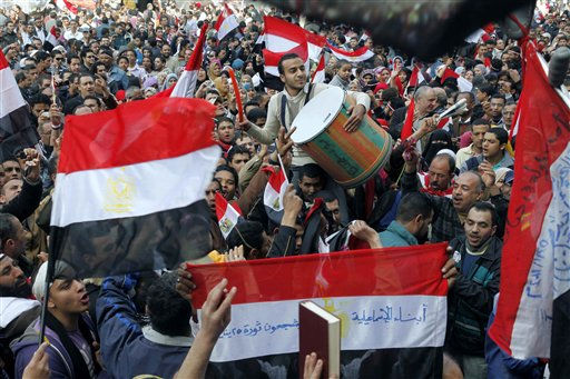 Egyptians dance and wave national flags in Tahrir Square in Cairo, Egypt, Saturday, Feb. 12, 2011. Egypt exploded with joy, tears, and relief after pro-democracy protesters brought down President Hosni Mubarak with a momentous march on his palaces and state TV. Mubarak, who until the end seemed unable to grasp the depth of resentment over his three decades of authoritarian rule, finally resigned Friday and handed power to the military. &#40;AP Photo&#47;Manoocher Deghati&#41; <span class=meta>(AP Photo&#47; Manoocher Deghati)</span>
