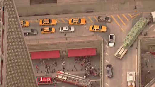 "<div class=""meta image-caption""><div class=""origin-logo origin-image ""><span></span></div><span class=""caption-text"">A truck turned a corner, knocking into a concrete barrier, sending concrete below to 42nd street outside of Grand Central Station.</span></div>"