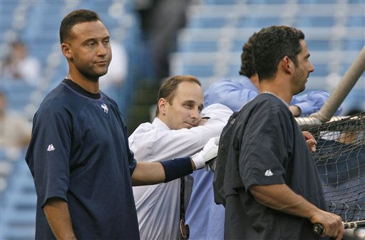 New York Yankees shortstop Derek Jeter, left, General Manager Brian Cashman, center, and catcher Jorge Posada are shown near the batting cage before Game 4 of their American League Division Series playoff baseball loss to the Cleveland Indians at Yankee Stadium in New York, Monday, Oct. 8, 2007.  &#40;AP Photo&#47;Kathy Willens&#41; <span class=meta>(AP Photo&#47; Kathy Willens)</span>