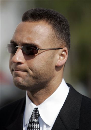 New York Yankees shortstop Derek Jeter talks with reporters as he arrives at a memorial service for the late Yankee pitcher Cory Lidle, in West Covina, Calif., Tuesday, Oct. 17, 2006. Lidle was remembered as &#34;a loving husband and an awesome father&#34; Tuesday at a memorial attended by family, friends and teammates of the avid yet inexperienced pilot who was killed last Wednesday during an aerial tour of New York City. &#40;AP Photo&#47;Reed Saxon&#41; <span class=meta>(AP Photo&#47; REED SAXON)</span>